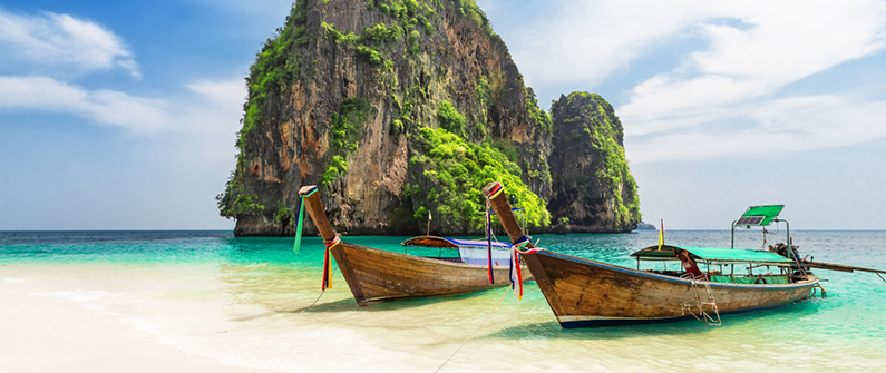 The ancient limestone karst formations that rise from the Andaman Sea are a distinctive feature of Phuket's shining seascapes
