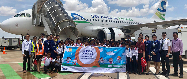 Several local airlines offered to take the children on tours of their planes. Here, a class gathers at the Siem Reap International Airport to pose with the crew of Sky Angkor Airlines