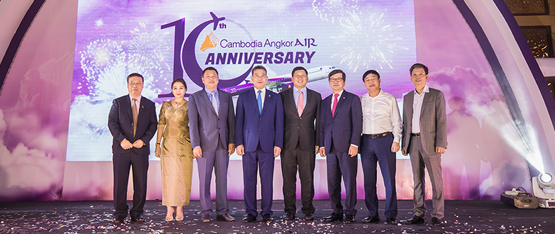 Government and airport officials commemorate the flag carrier's decade of success