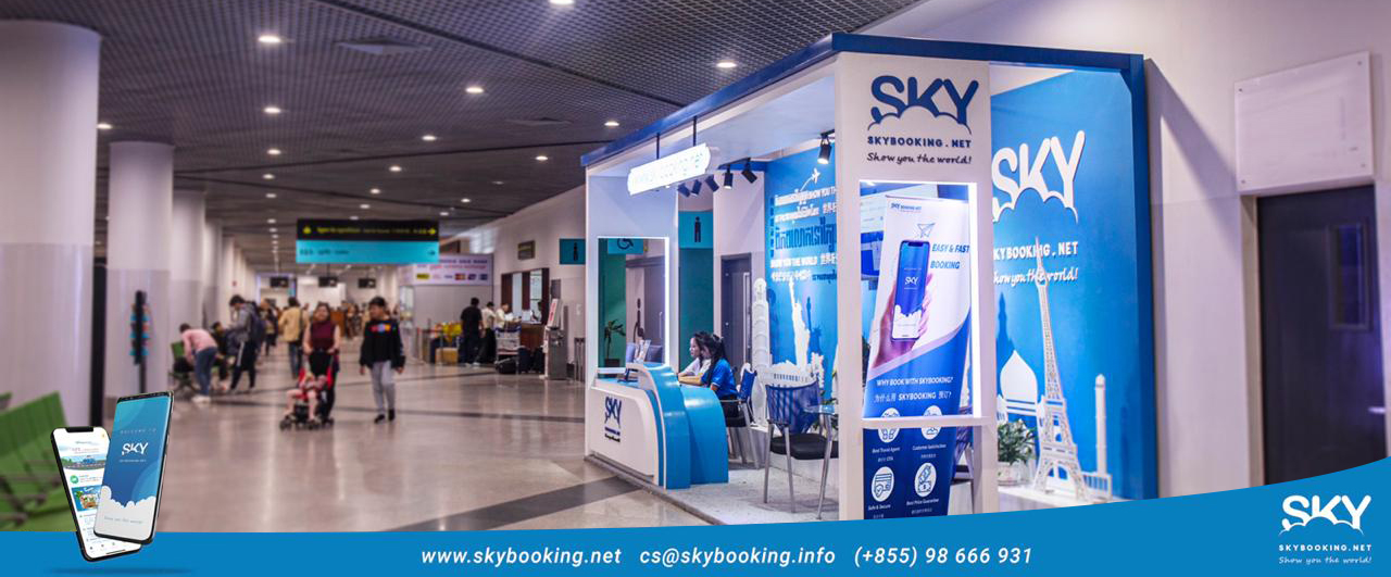 Skybooking.net representatives await questions from curious travelers at Phnom Penh International Airport.